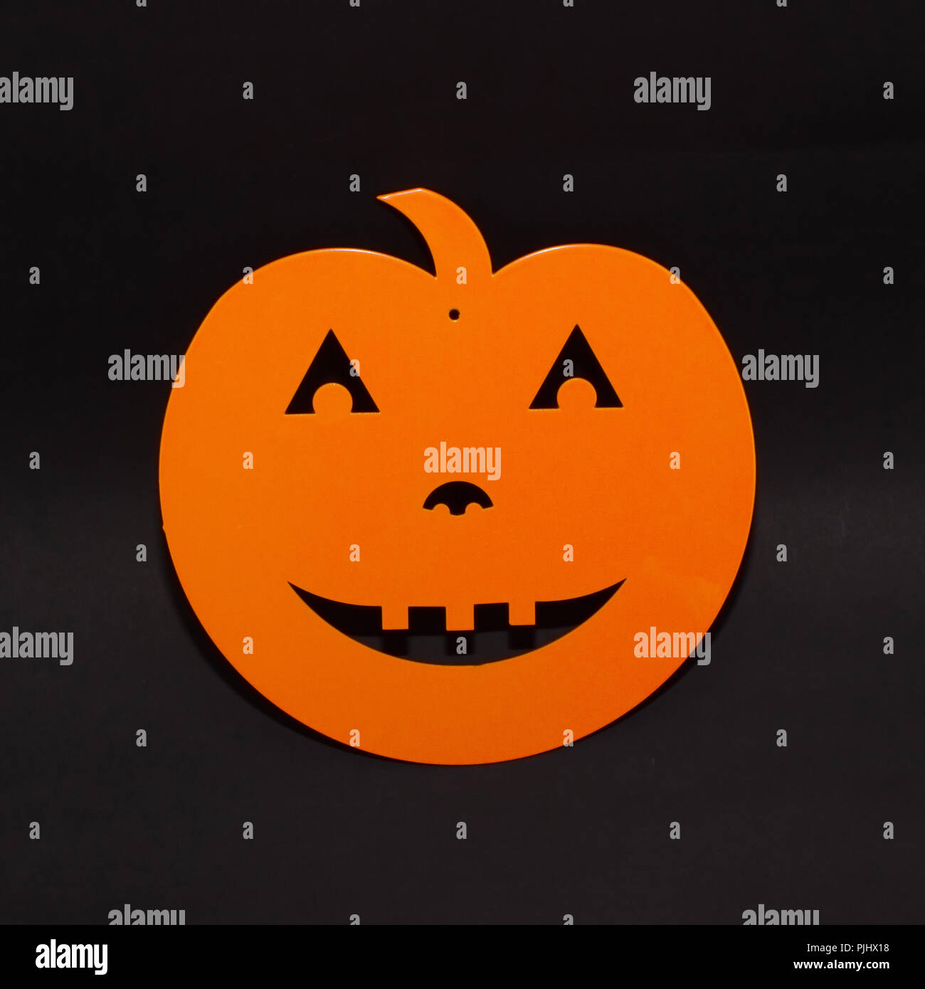 halloween background decor holiday concept orange pumpkin funny face shadow and silhouette on black background