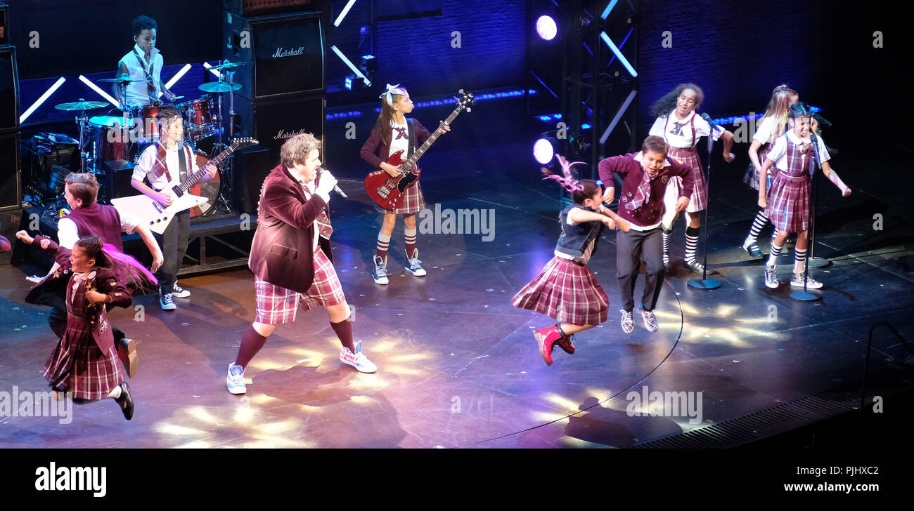 Pic shows: School of Rock finale at Gillian Lynne Theatre in  Drury Lane.  Kids of the cast rock out with Ed Scheebly and Dewey Finn played by Alan Pe Stock Photo