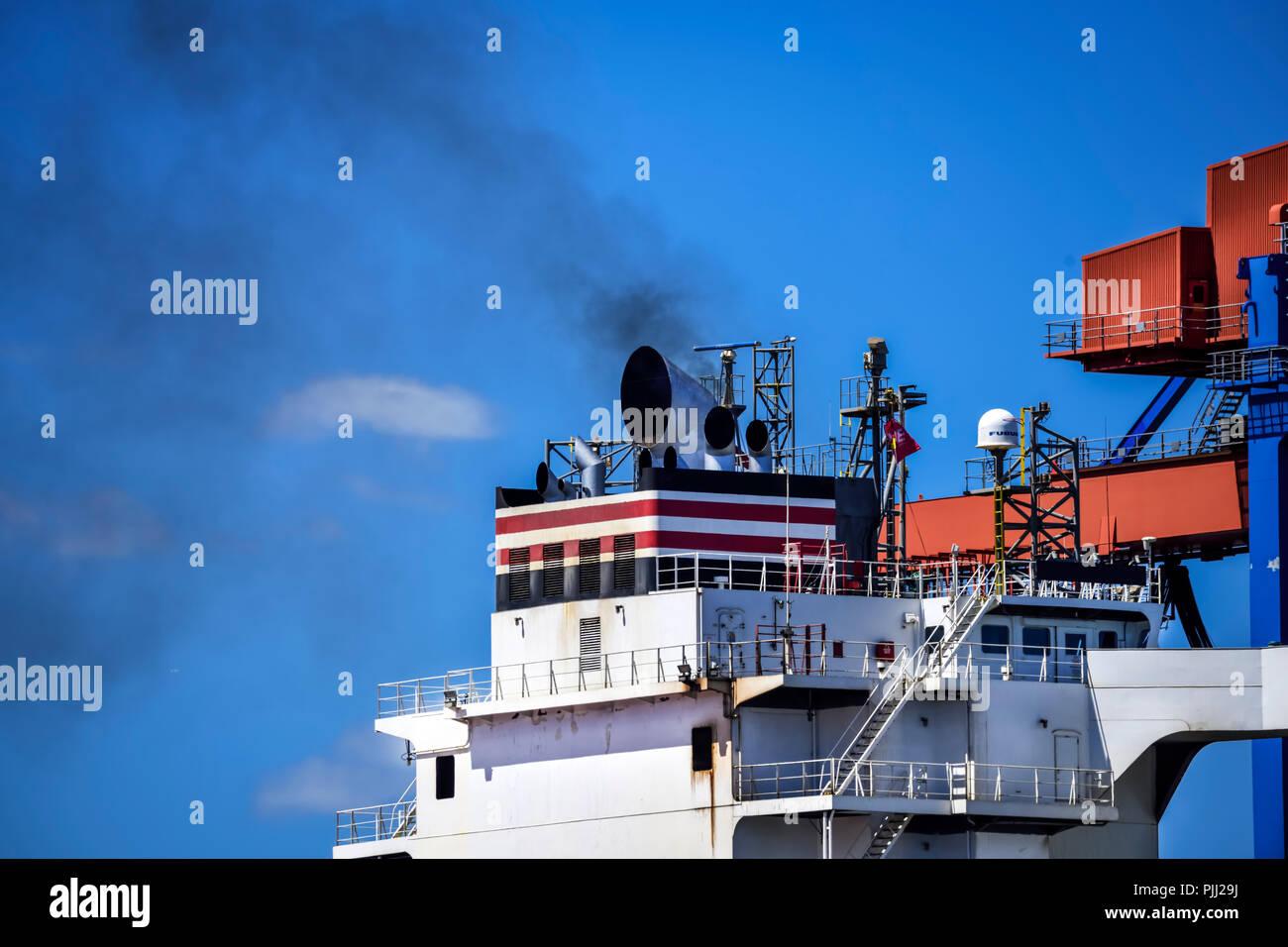 Smoking chimney of a container ship in Hamburg, Germany, Europe, Rauchender Schornstein eines Containerschiffes in Hamburg, Deutschland, Europa Stock Photo