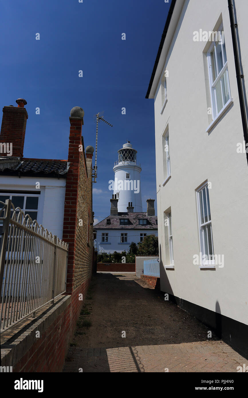 The Trinity House Lighthouse towers above local houses at Southwold, Suffolk, UK - Stock Image