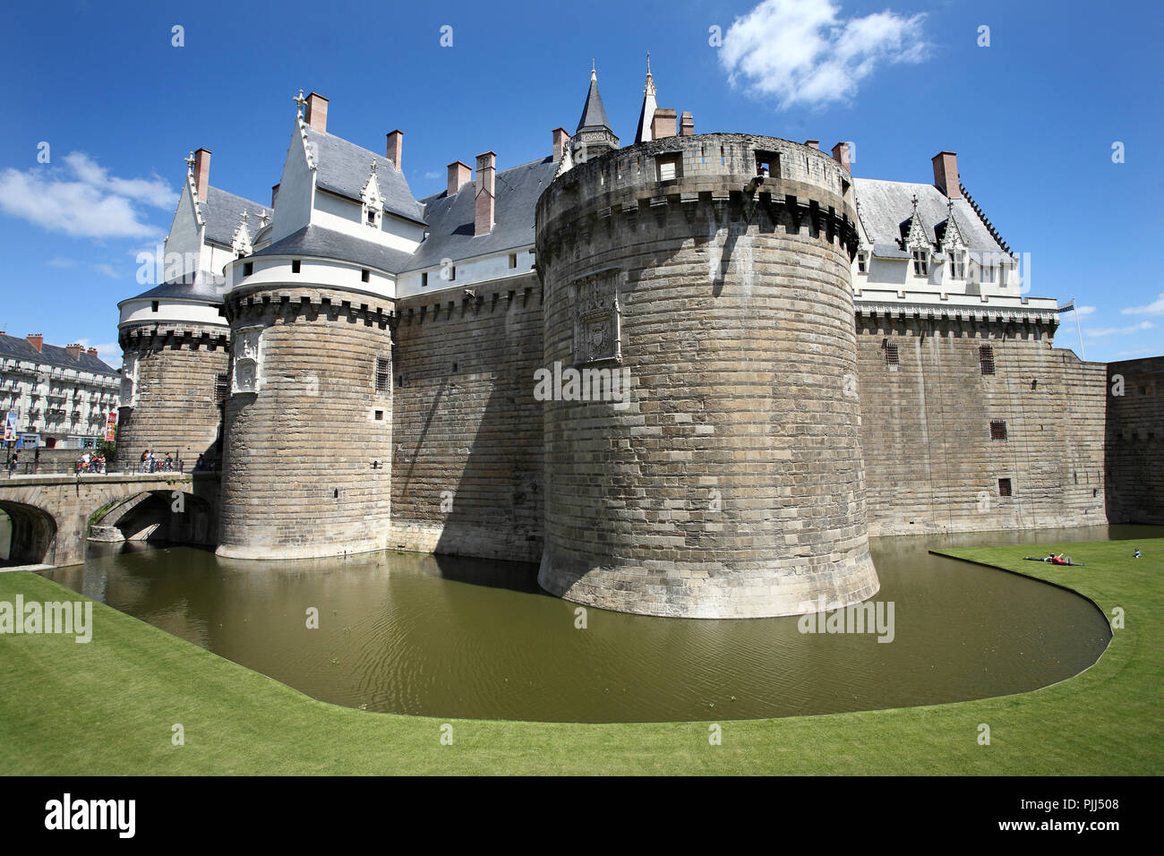 France, Medieval part of the Nantes castle in the city center, with its bridge, defense towers and water filled moats. - Stock Image