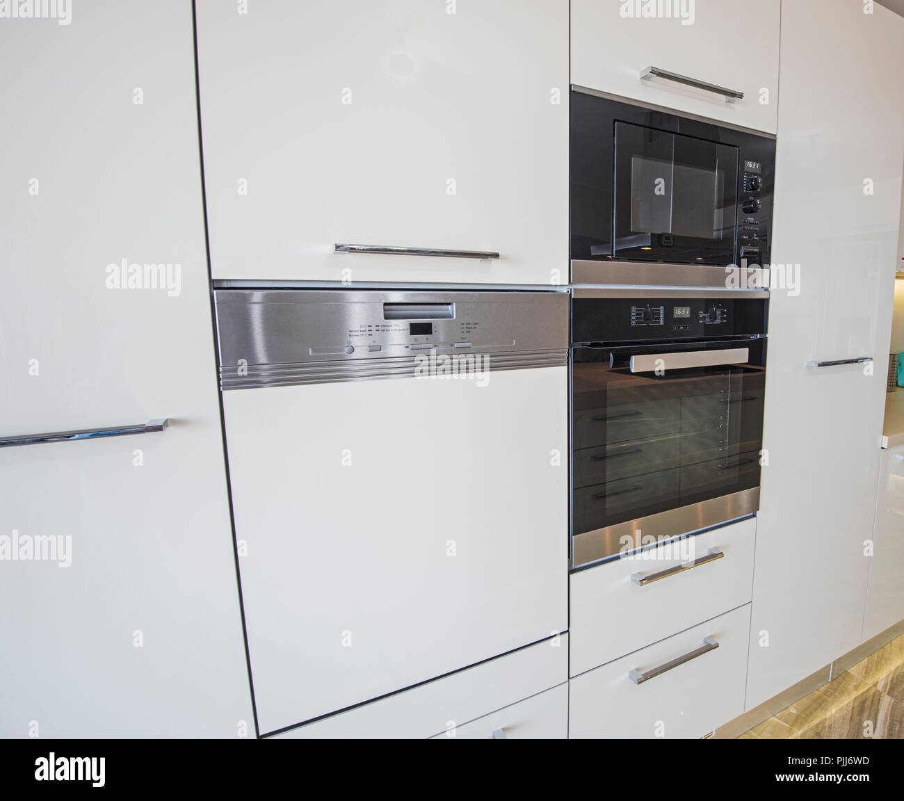 Interior Design Decor Showing Modern Kitchen And Oven Cooker Appliances In  Luxury Apartment Showroom
