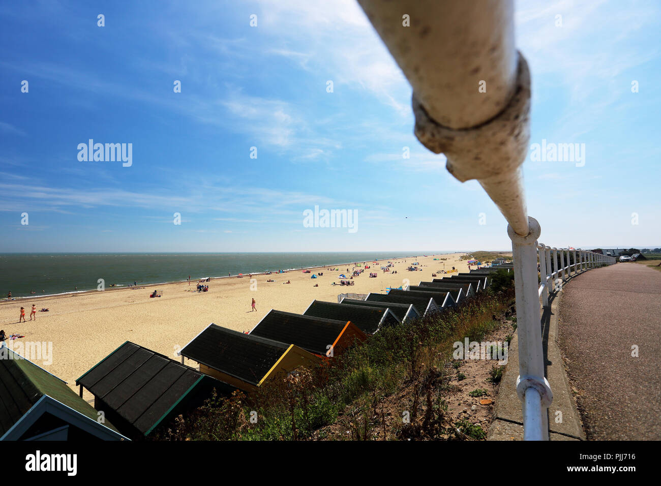 A line of bathing huts on the promenade at Southwold, Suffolk, UK - Stock Image