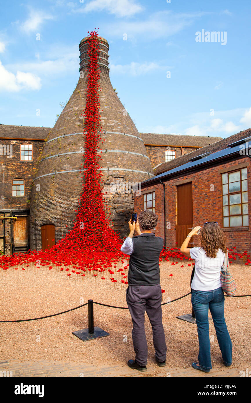 Weeping windows touring display of ceramic poppies at its Stoke on Trent venue of Middleport pottery each representing a dead soldier from the war - Stock Image