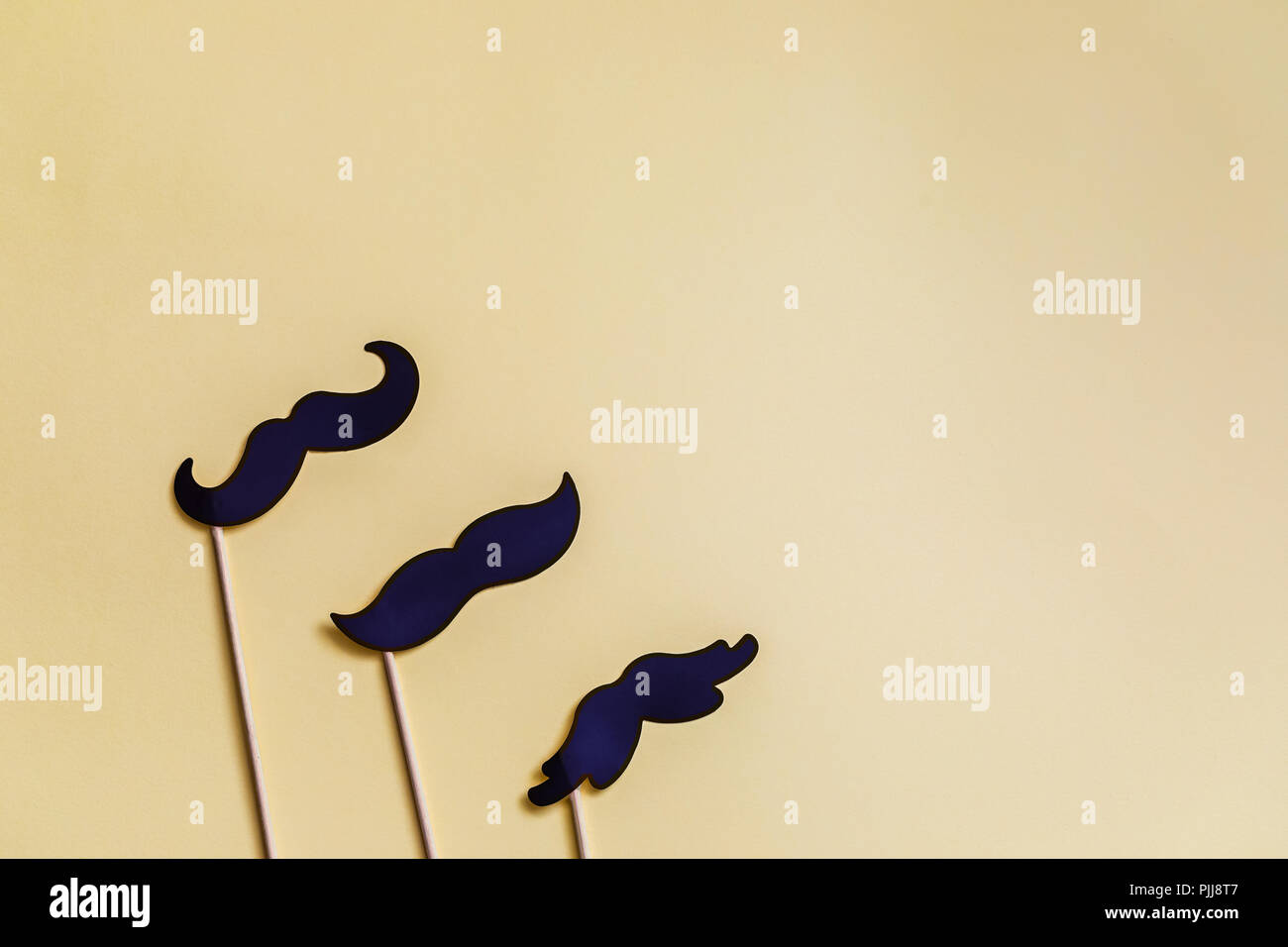 Happy Movember with Copy Space. Moustache photo booth props, yellow background - Stock Image