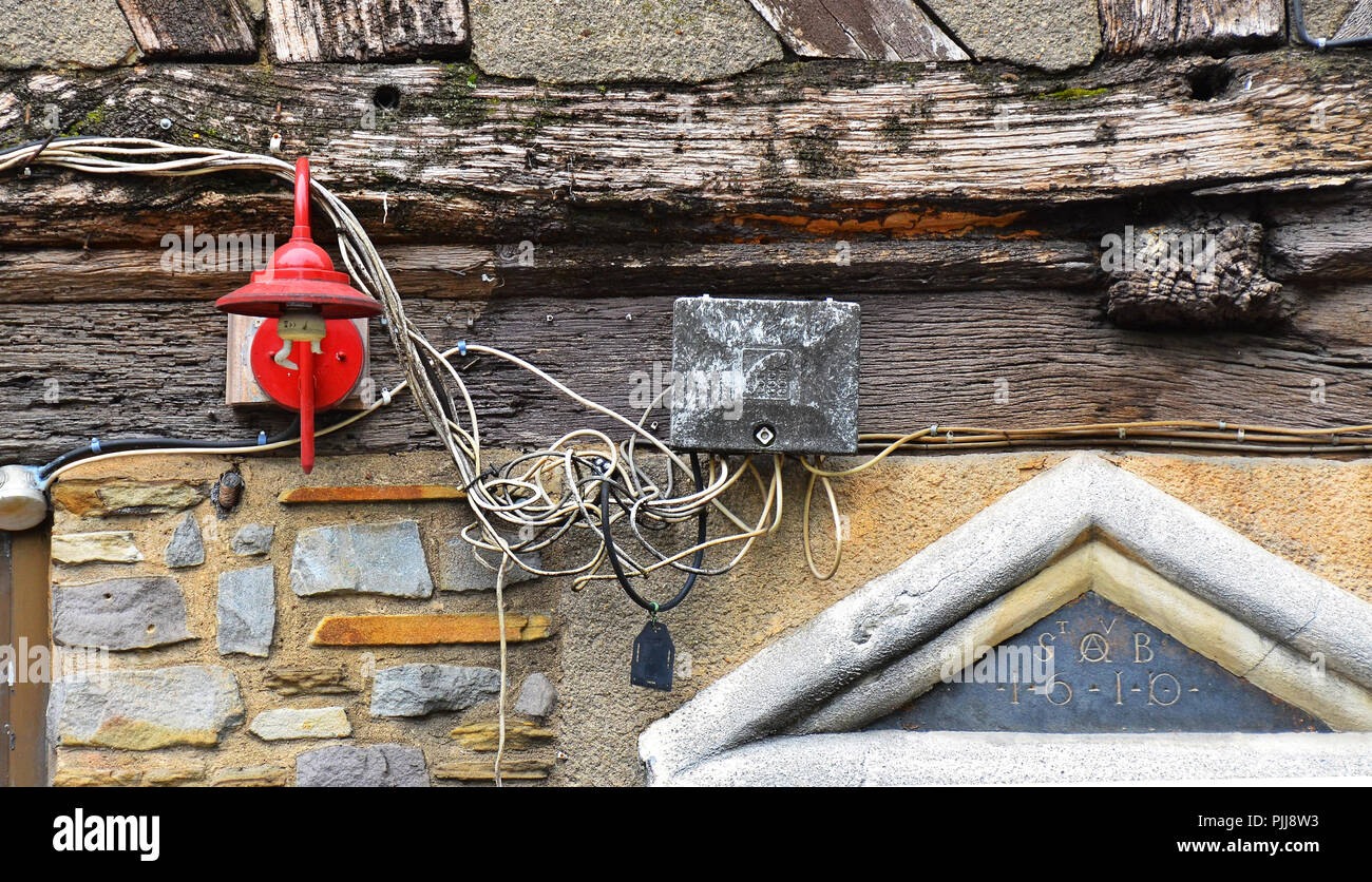 hazardous, dangerous, risky electric cabling, wiring, installazion outside  of an an old house in Rouen, Normandy, France