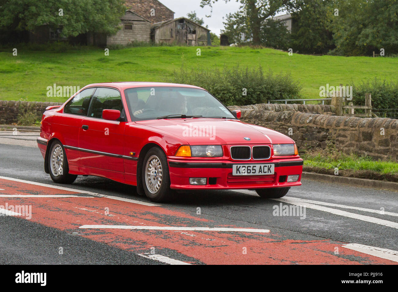 Red K365ACK 1993 BMW 318 I S Classic, vintage, veteran, cars of yesteryear, restored collectibles at Hoghton Tower Class Cars Rally, UK - Stock Image