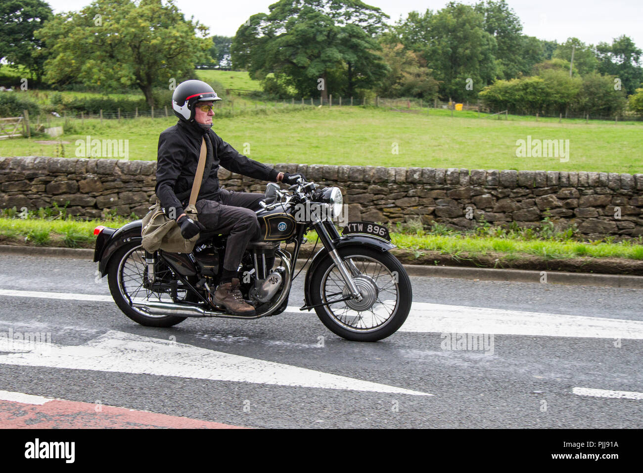 Black 1954 AJS Classic, vintage, veteran, motorcycle of yesteryear, restored collectibles at Hoghton Tower Class Cars Rally, UK - Stock Image