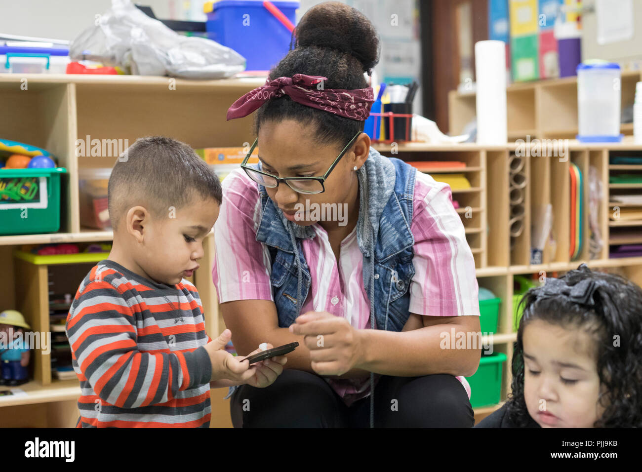 Houston, Texas - A child in the two-year-olds classroom of Wesley Community Center's Early Childhood Education program. - Stock Image