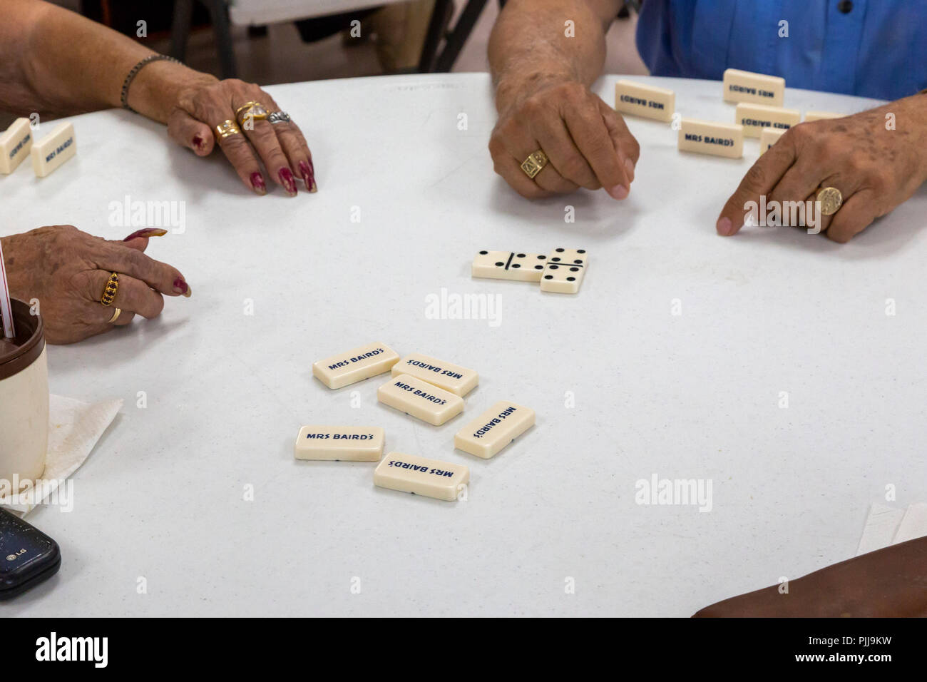 Houston, Texas - Senior citizens play dominoes at Wesley Community Center. - Stock Image