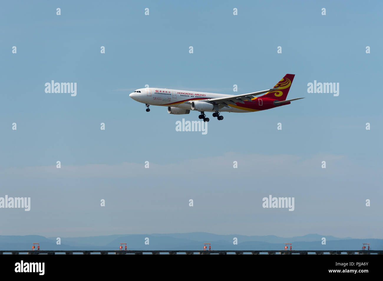 Hong Kong Airlines Wide Body A 350 on approach to Vancouver International Airport. - Stock Image