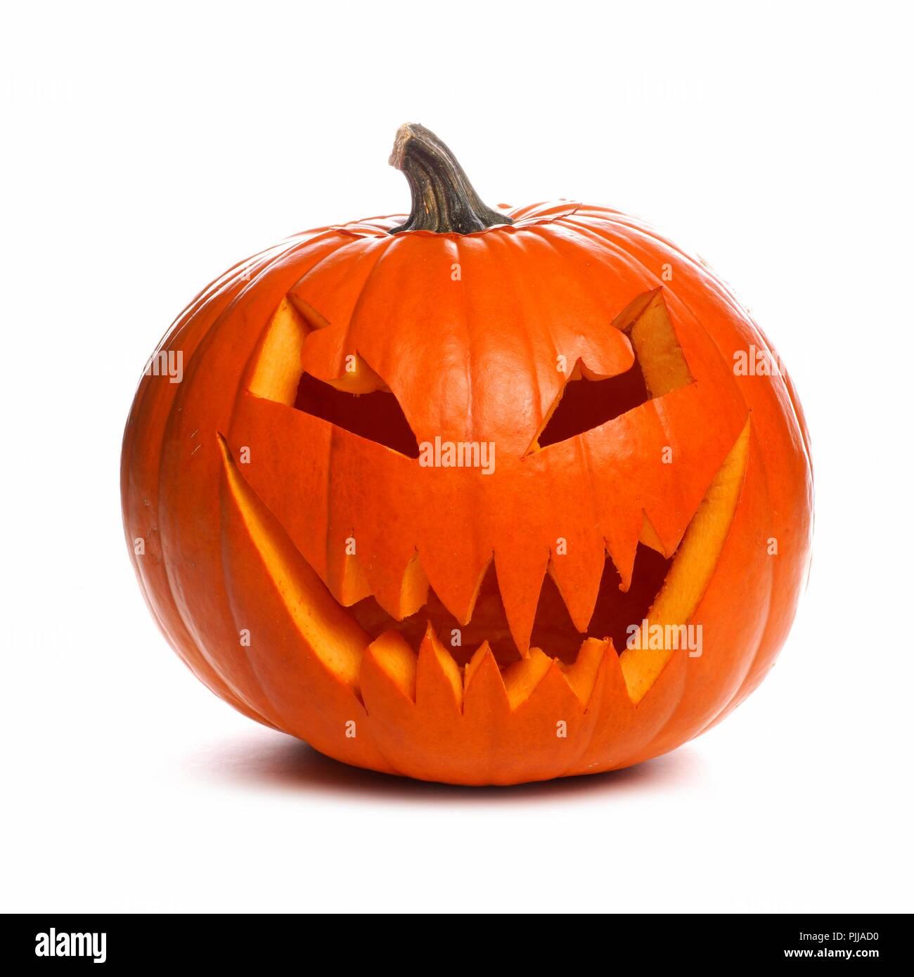 Spooky Halloween Jack o Lantern isolated on a white background - Stock Image