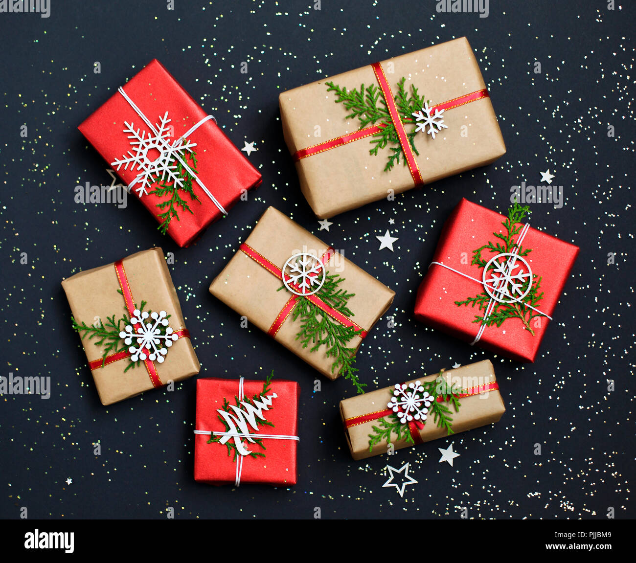 Christmas Greeting Card Making.Christmas Handmade Red Gift Boxes On Dark Background Top