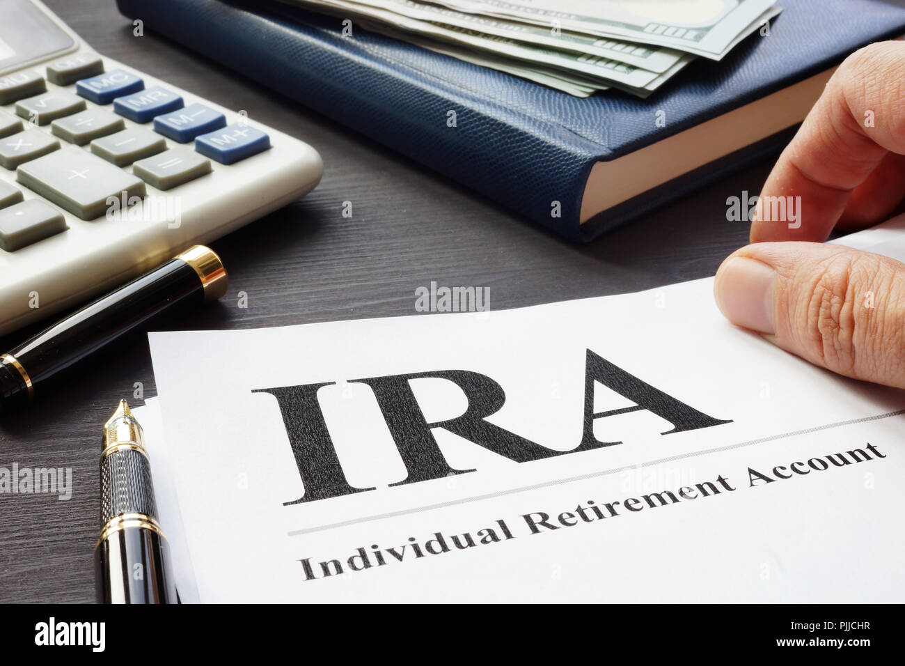 documents about individual retirement account ira on a desk stock