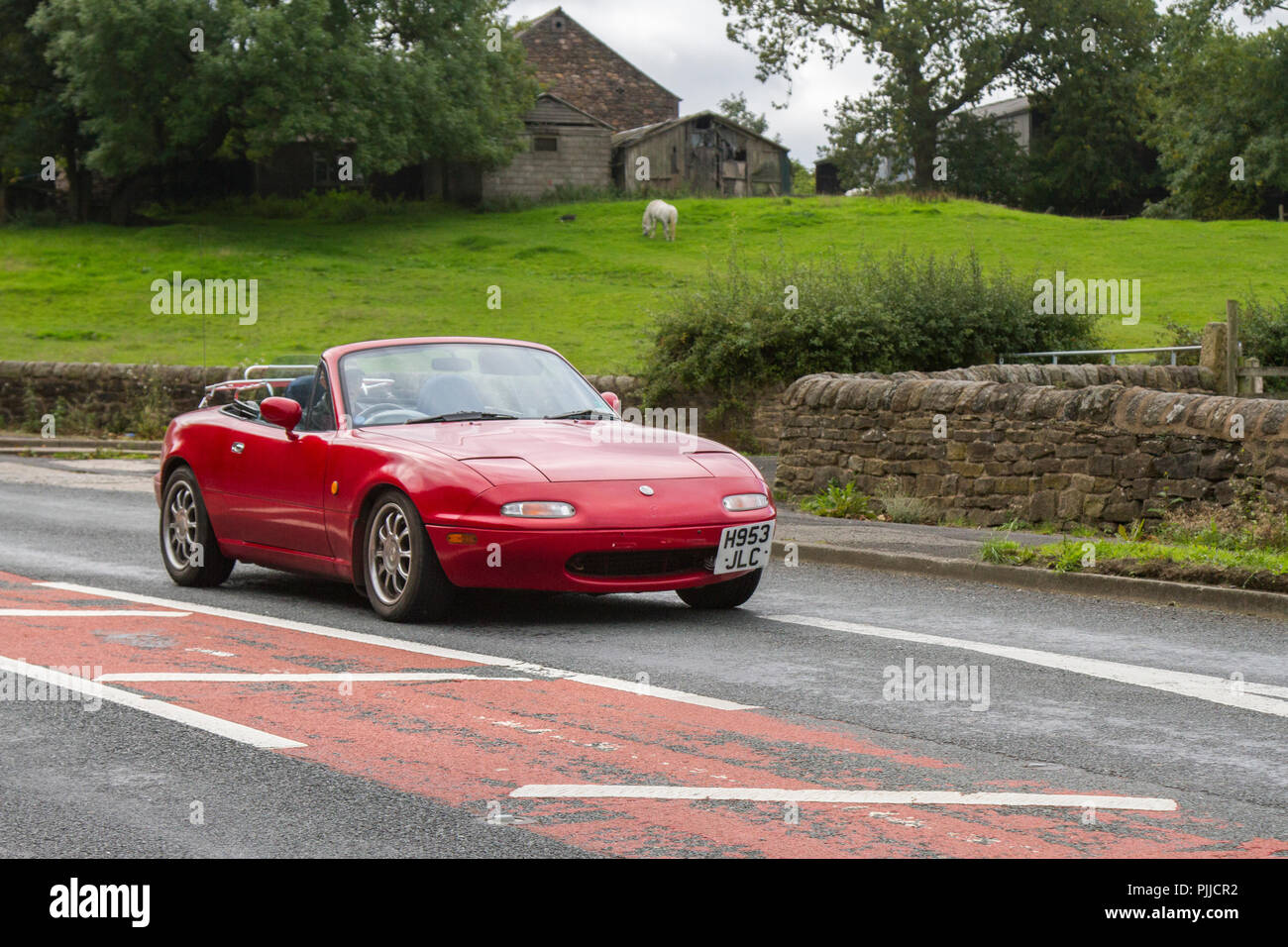 H953JLC Red 1991 Mazda Classic, vintage, veteran, cars of yesteryear, restored collectibles at Hoghton Tower Class Cars Rally, UK - Stock Image