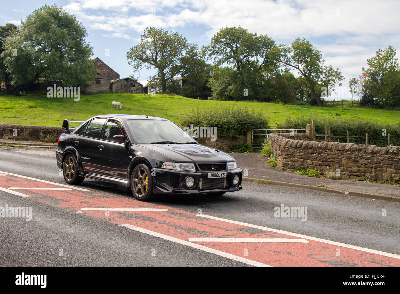 J800lys Black Mitsubishi Lancer EVO V Classic, vintage, veteran, cars of yesteryear, restored collectibles at Hoghton Tower Class Cars Rally, UK Stock Photo