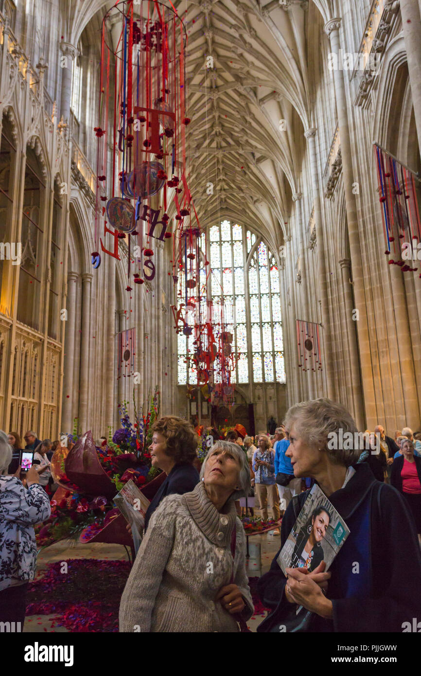 Winchester, Hampshire, UK. 7th Sep 2018. Thousands visit Illumination Festival of Flowers 5-9 September to see over 50,000 flowers and 400 different variations of flowers and foliage in Winchester Cathedral – the fragrance and colour evoking the senses as visitors wander round.   A stunning array of flower arrangements inspired by the magnificent Winchester Bible, the largest and finest surviving 12th century English Bible. Visitors look up as petals fall from the ceiling. Credit: Carolyn Jenkins/Alamy Live News - Stock Image