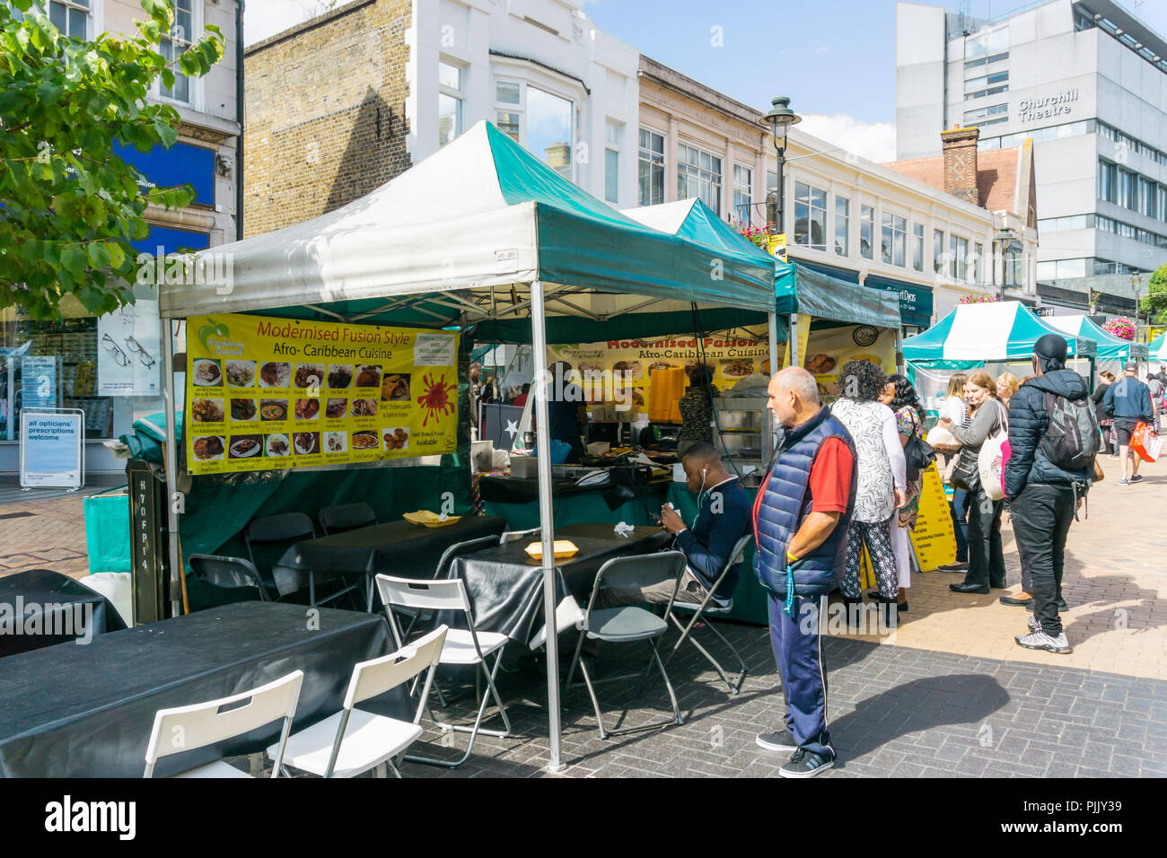 Street food stall in Bromley High Street selling modernised fusion style Afro-Caribbean Cuisine. - Stock Image