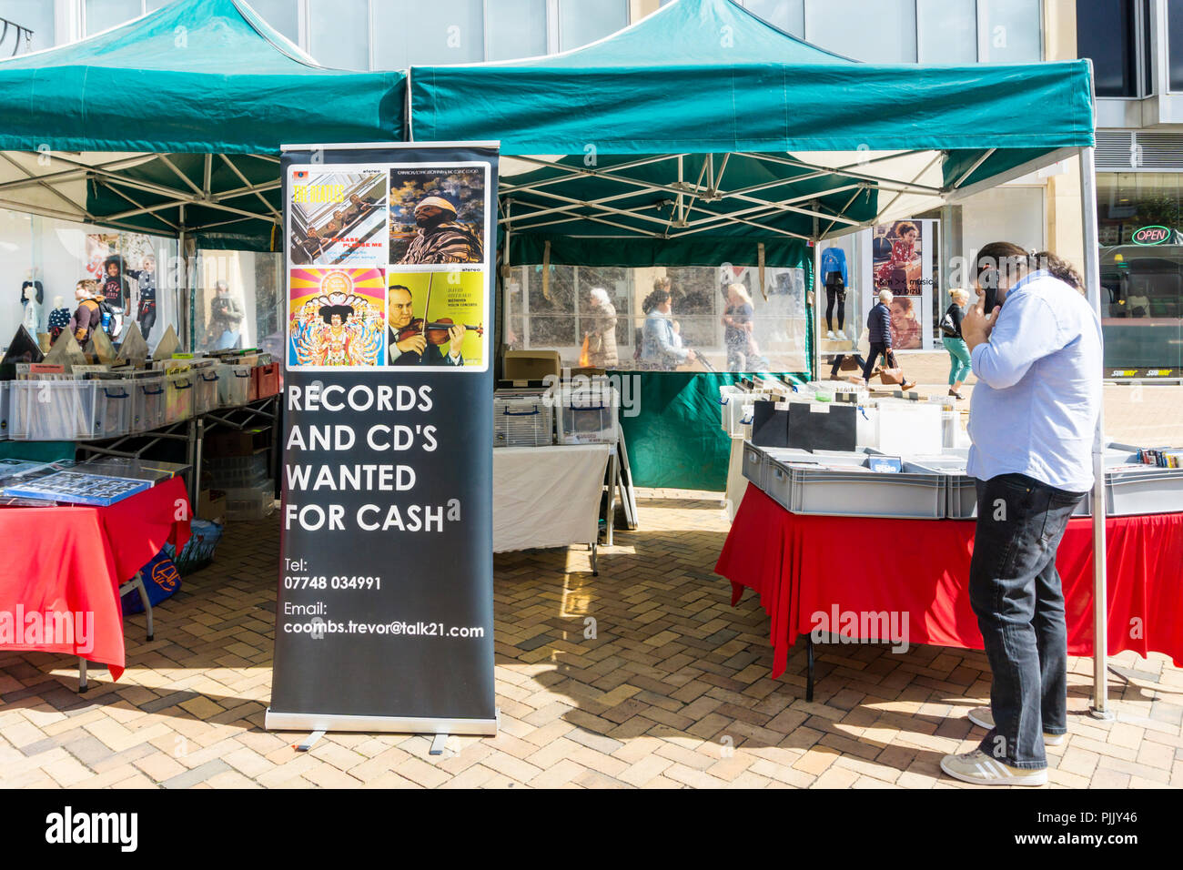 A market stall in Bromley High Street buys and sells used vinyl records and CDs. - Stock Image
