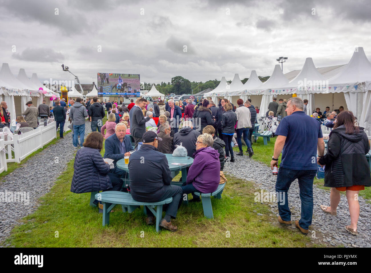 Racegoers in the Paddock enclosure at Cartmel Races on August Bank Holiday 2018, Cartmel, Cumbria, England, UK Stock Photo