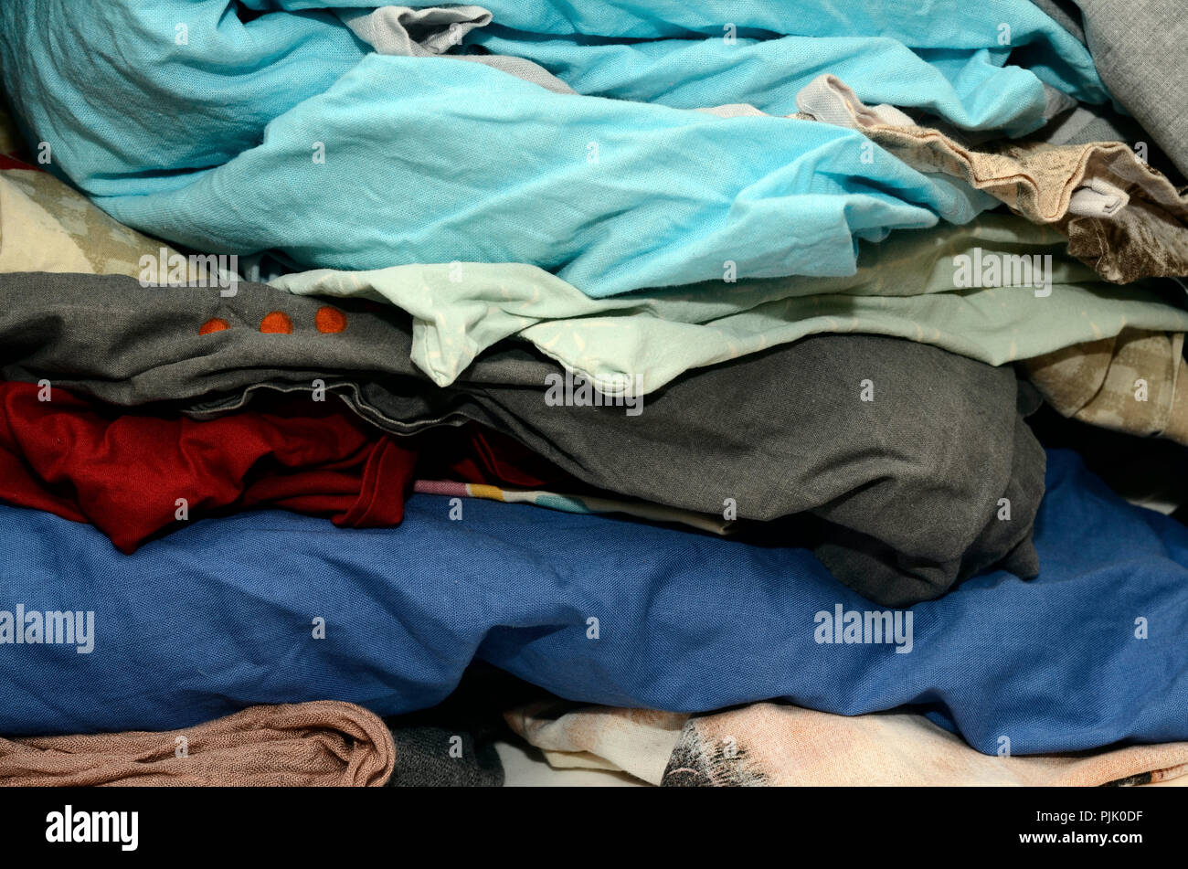 Stack of crumpled sheets for ironing need illustration - Stock Image