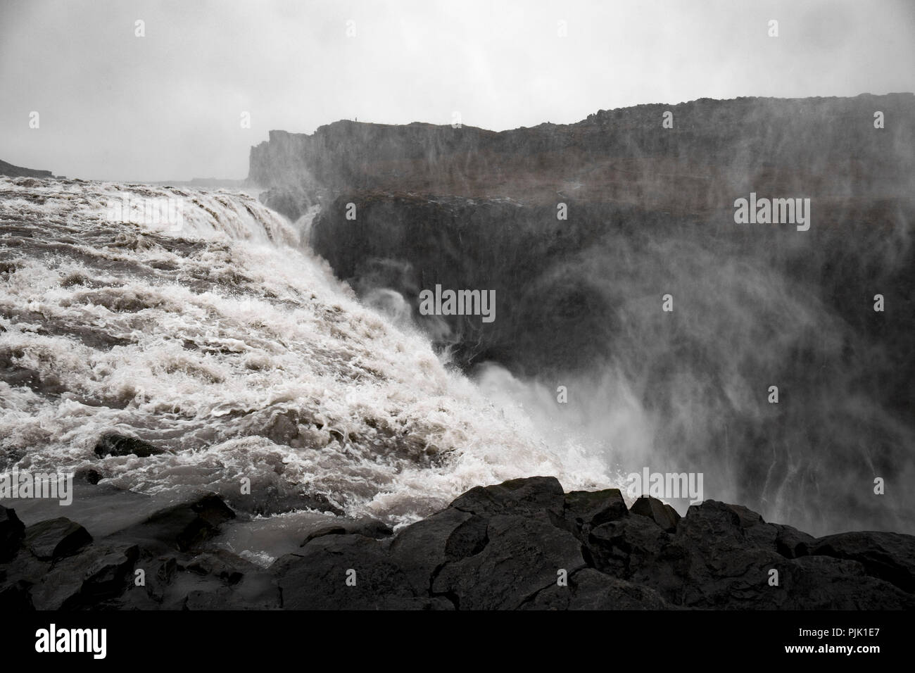 The mighty waterfall Dettifoss in a rough rocky environment - Stock Image