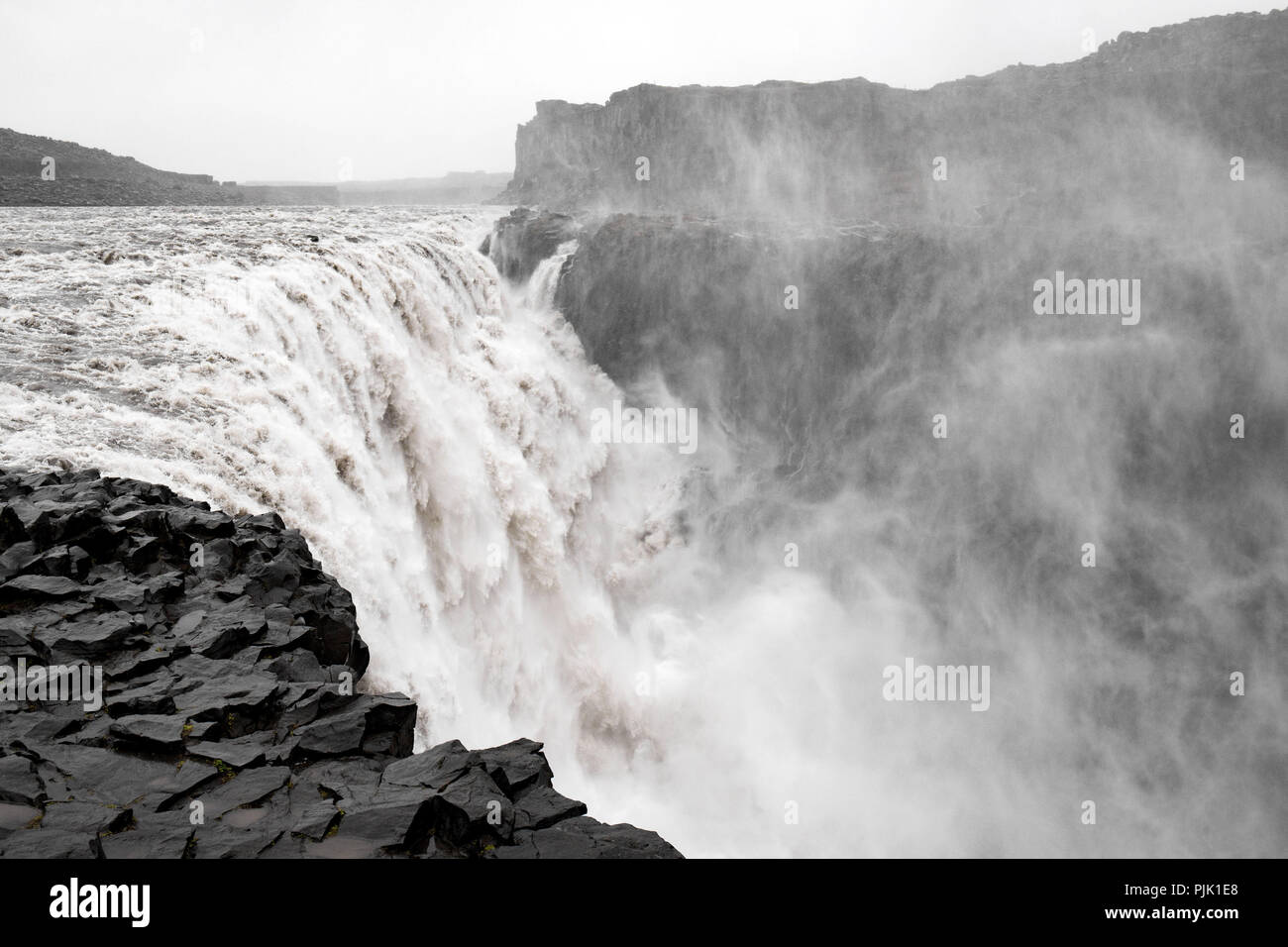 The mighty waterfall Dettifoss in a rough rocky environment Stock Photo