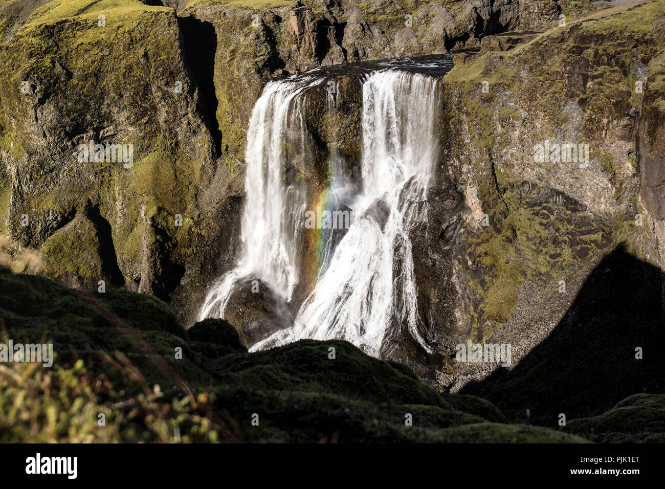A mighty waterfall with rainbow in Iceland - Stock Image