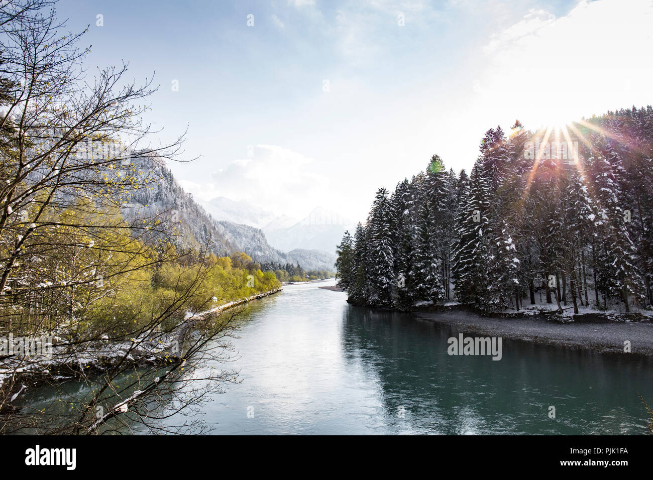 The transition between winter and spring at Lech river in Allgäu region - Stock Image