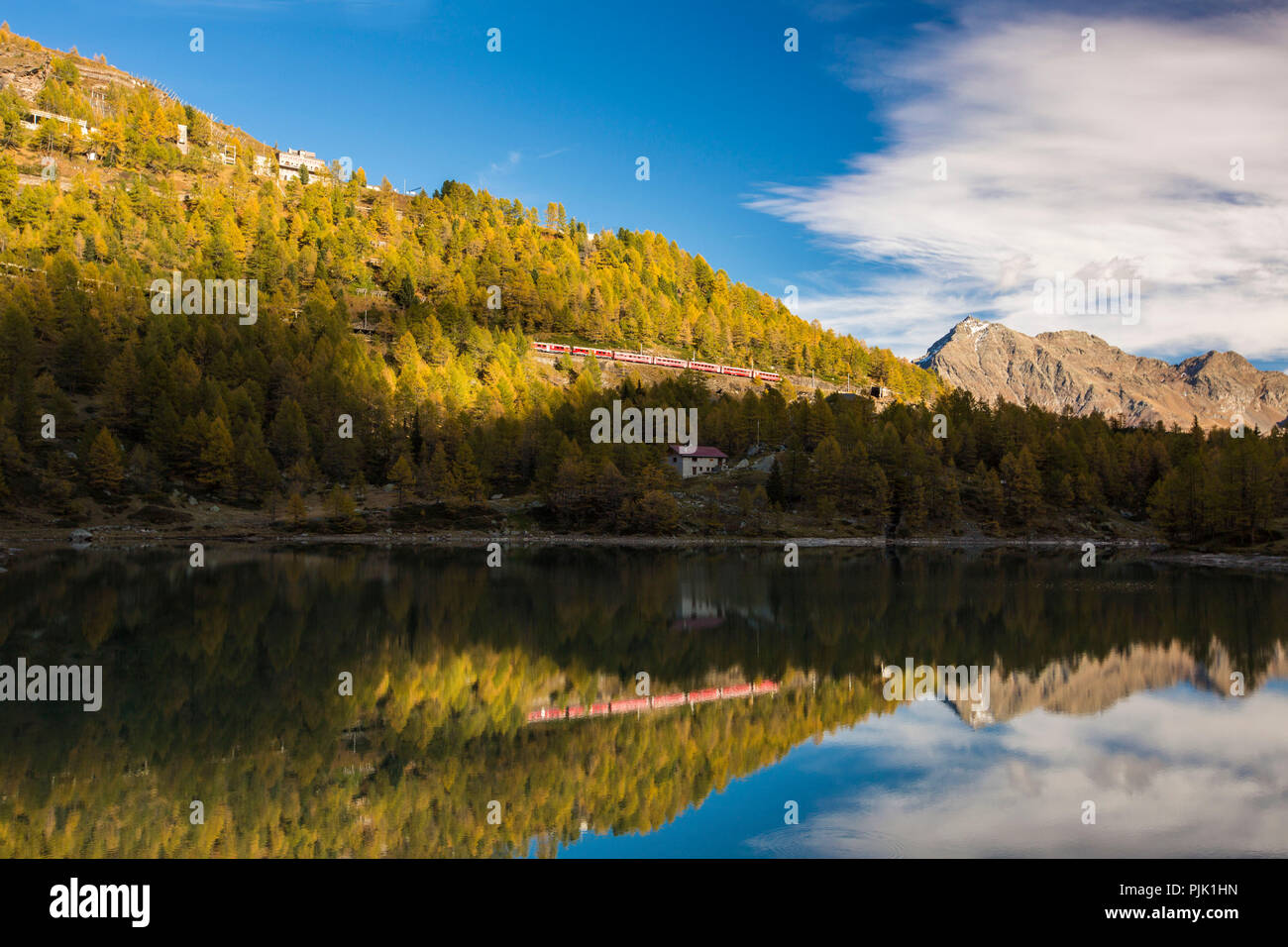 Light and shade determine the autumnal landscape on Lake Palü in the Alp Grüm, canton of Grisons, Switzerland - Stock Image