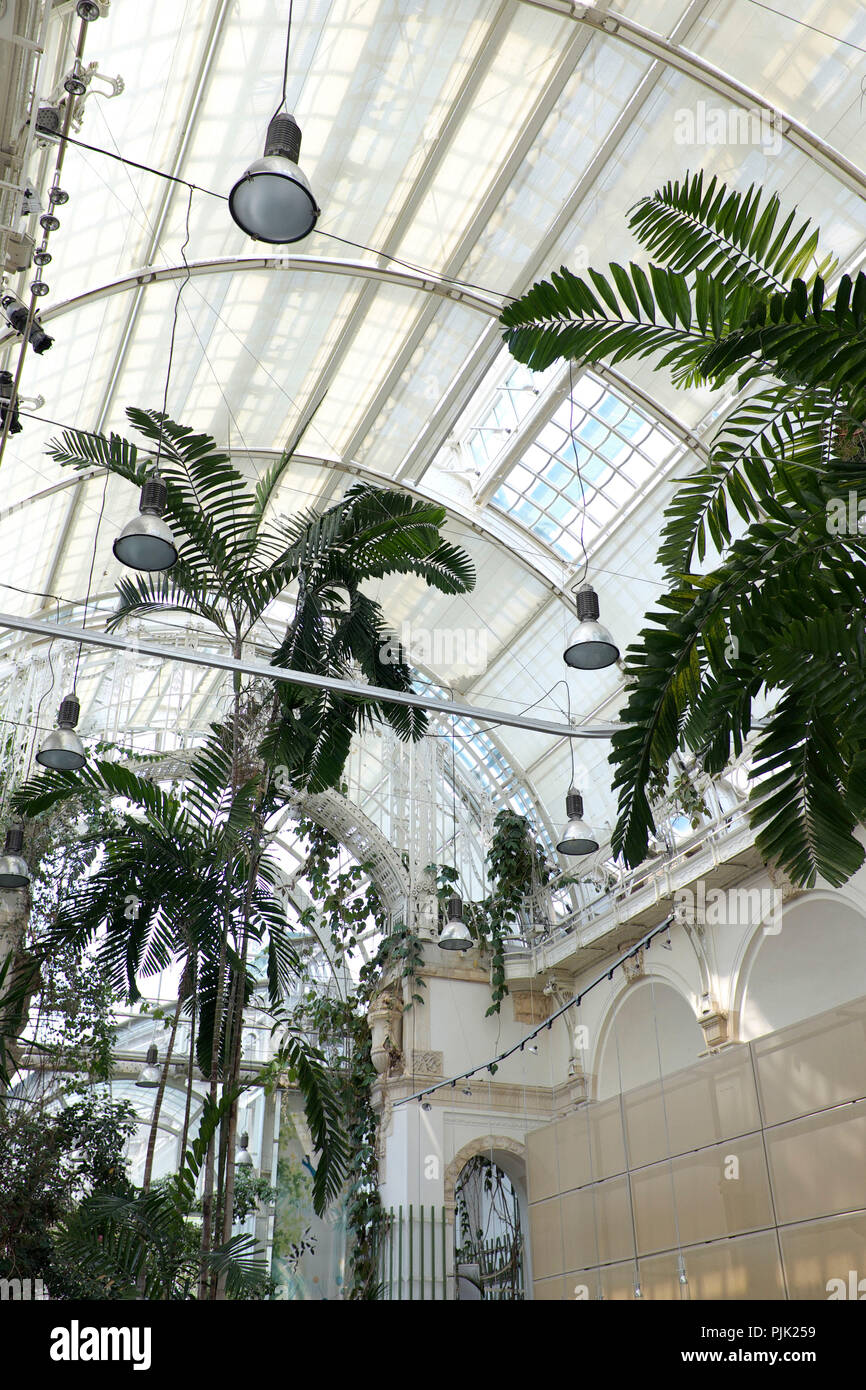 The palm house in the castle garden, partly used by a gastronomic enterprise, Vienna, Innere Stadt, Austria - Stock Image