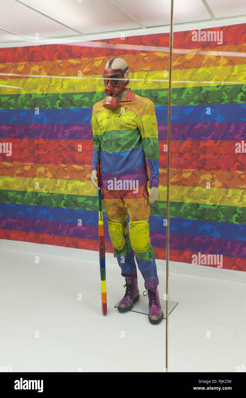 Soldier in uniform in rainbow colors - Stock Image
