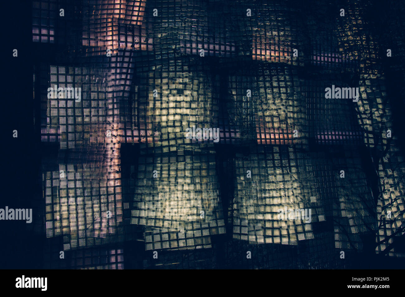 Glass facade of a parking garage, artistical photographed with the help of multiple exposure, - Stock Image