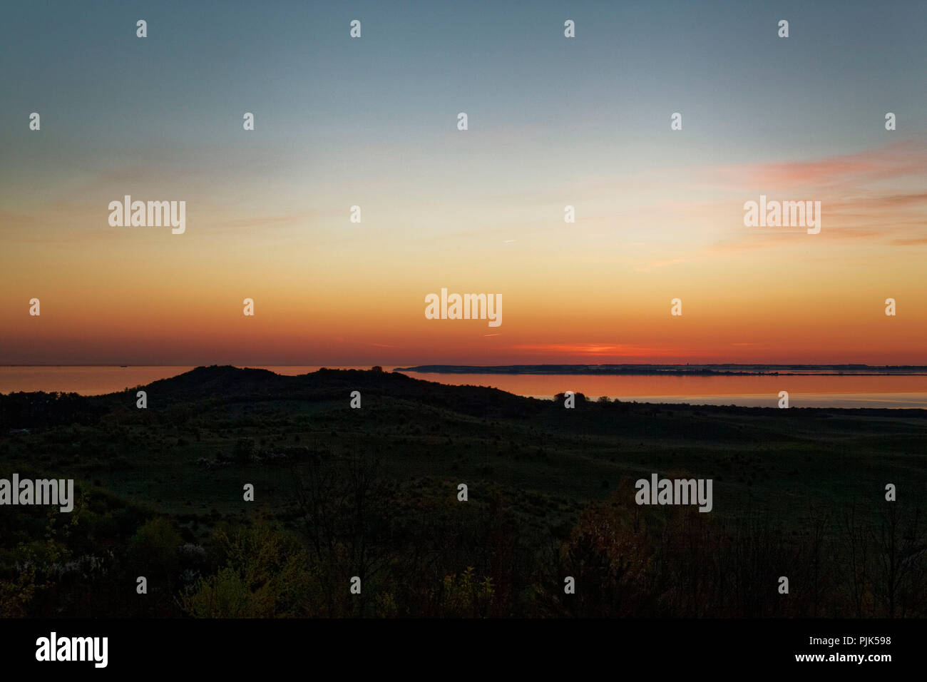 Sunrise over the Baltic Sea and the Bodden, seen from the island Hiddensee, Western Pomerania Lagoon Area National Park Stock Photo