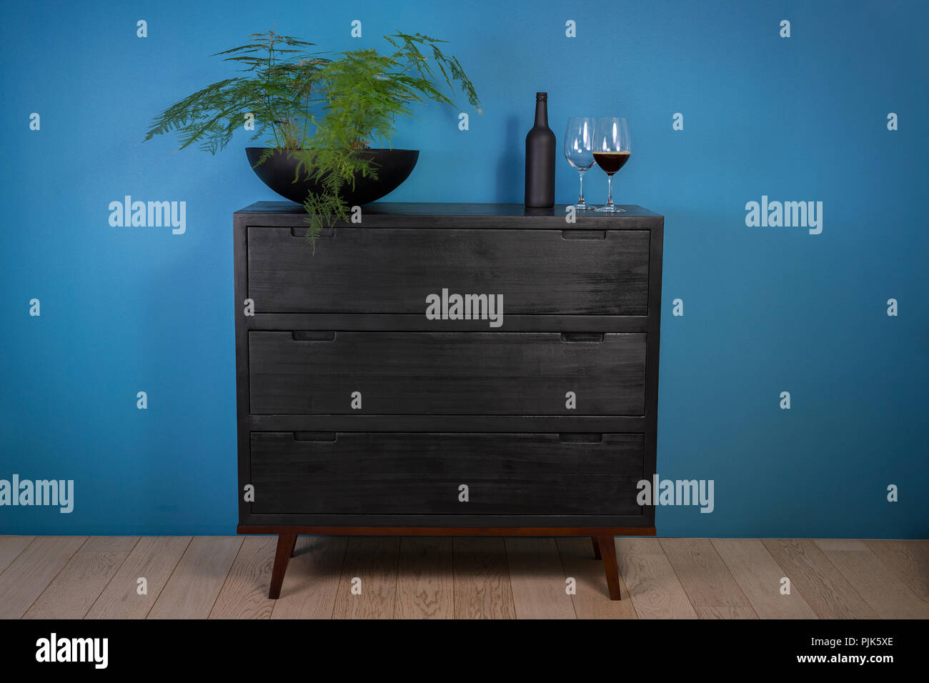 A Contemporary Chest Of Drawers To The Wood Superficially Burnt