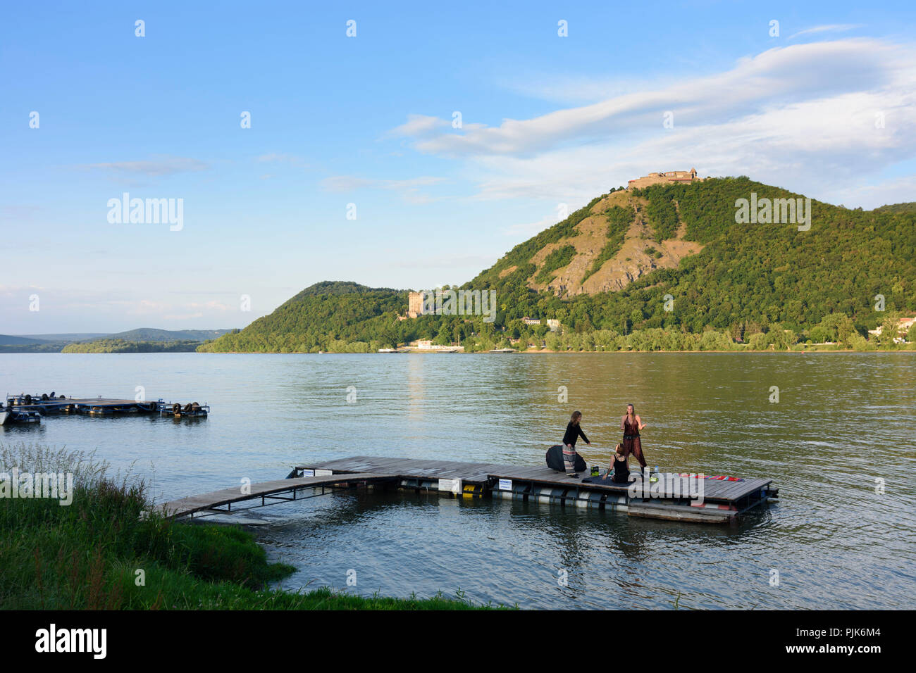 Visegrad (Plintenburg), river Danube, Upper and Lower Castle, view from Nagymaros, partying women at float in Hungary, Pest, Danube Bend (Dunakanyar) - Stock Image