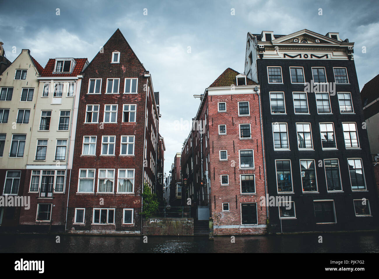 Netherlands, North Holland, Amsterdam, Houses on the Amstel River - Stock Image