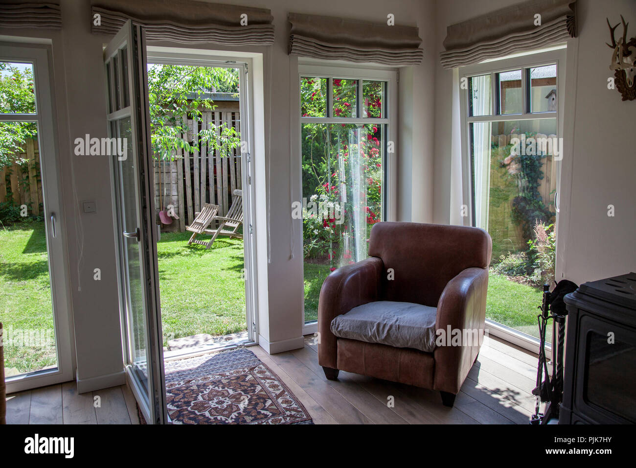 Cosy room with access to garden - Stock Image