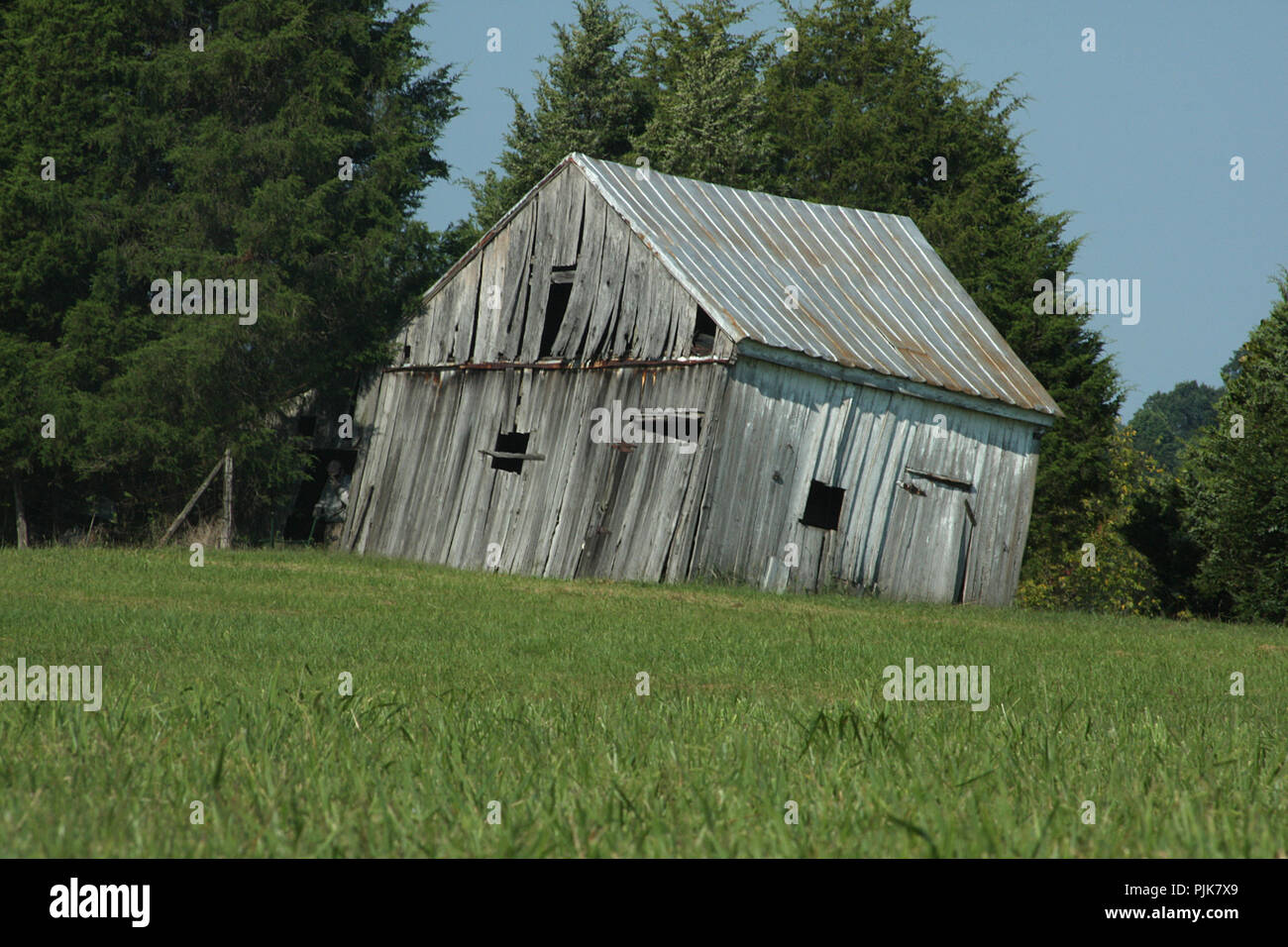 Wooden shed collapsing - Stock Image