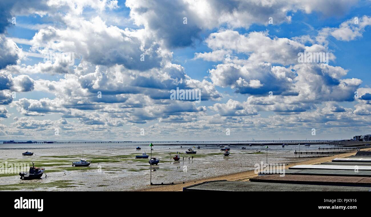 Taken on a blue sky day with awesome white clouds, to capture a spectacular backdrop for the longest pleasure pier in the world. - Stock Image