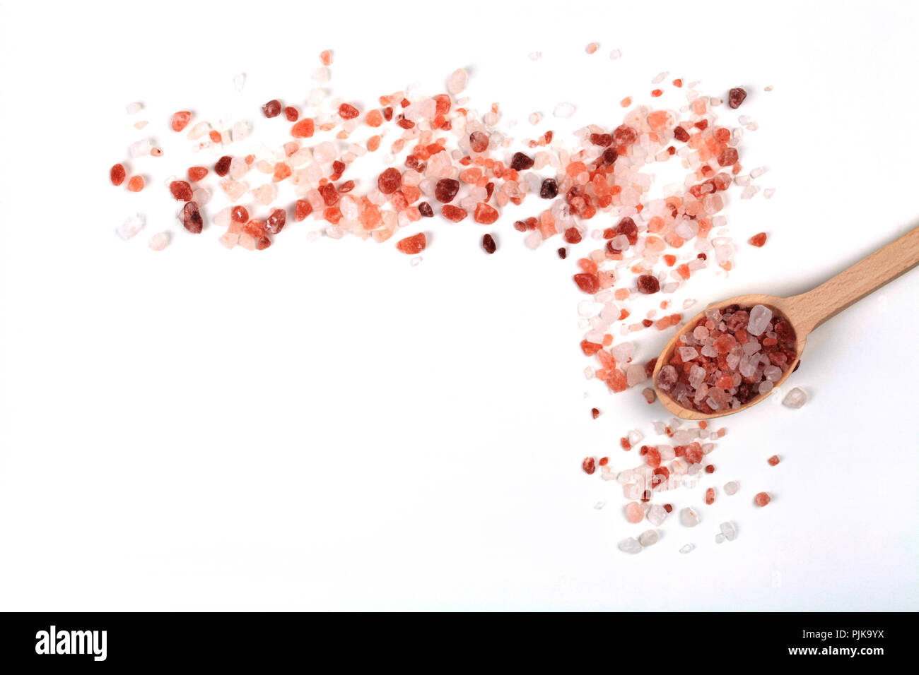 Himalayan Salt Cristals Frame With Brown Wood Spoon Isolated on White Background - Stock Image