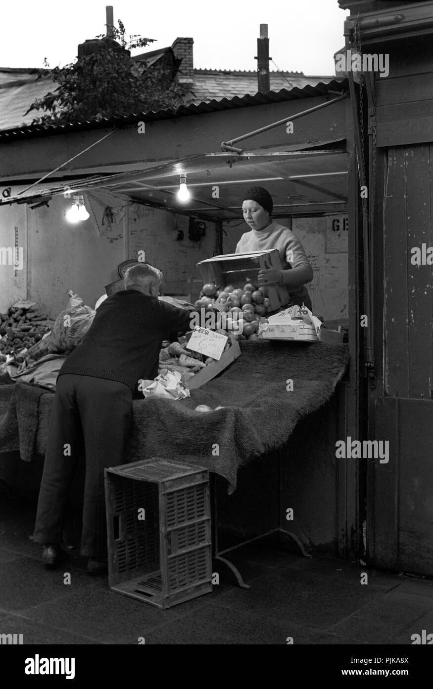 Wales, Cardiff, city centre, The Hayes Outdoor Market, 1979, fruit and vegetable stall setting up early morning - Stock Image