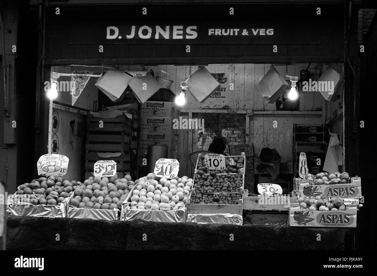 Wales, Cardiff, city centre, The Hayes Outdoor Market, 1979, D Jones fruit and vegetable stall setting up in early morning - Stock Image