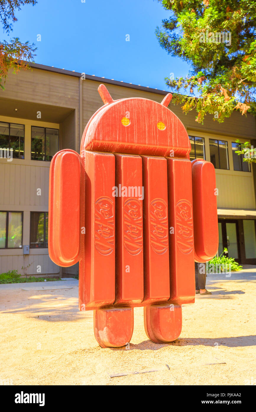 Mountain View, CA, United States - August 13, 2018: Android kitkat statue at Google's Merchandise Store and Google Visitor Center Beta. Android lawn are a popular place for selfies. Vertical shot - Stock Image
