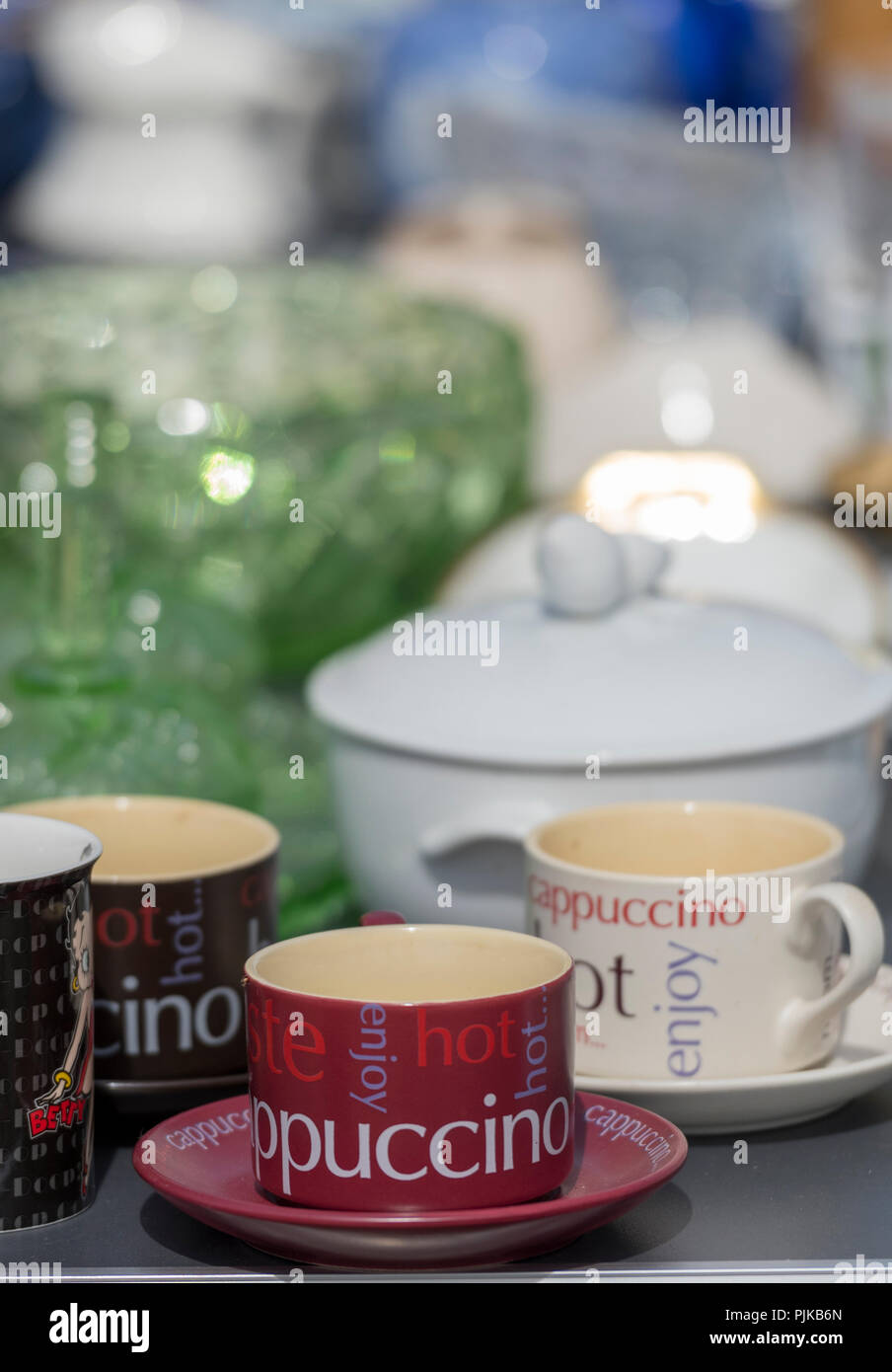 coffee cups and china with related coffee making paraphernalia and cups and saucers. - Stock Image