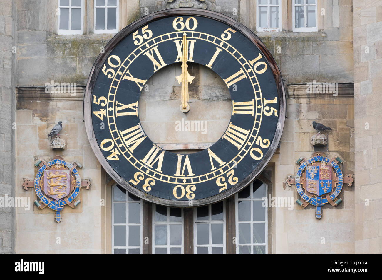 Midday (12 o'clock) at the clock on the wall of King Edward tower, which overlooks Great Court , Trinity college, university of Cambridge, England. - Stock Image