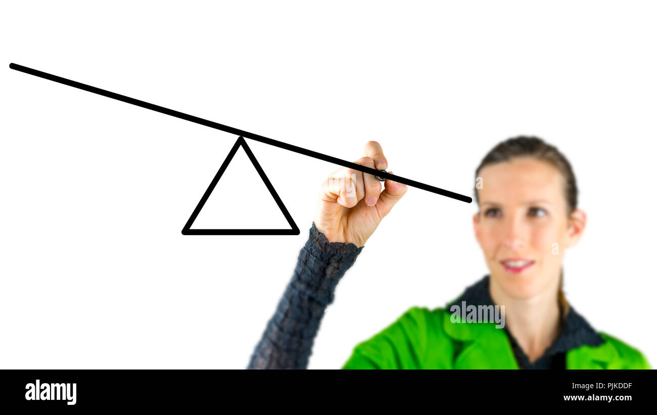 Woman drawing a seesaw on a virtual screen in a conceptual image of equilibrium and balancing opposing interests or forces - Stock Image