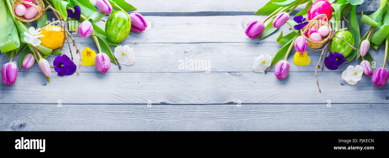 Easter Background Spring Flowers And Easter Eggs On Wood Banner