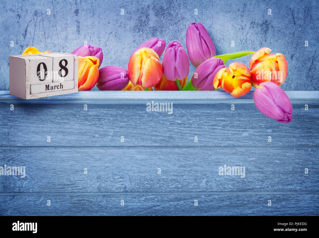 Women's Day, March 8, greeting card with pink tulips and calendar - Stock Image