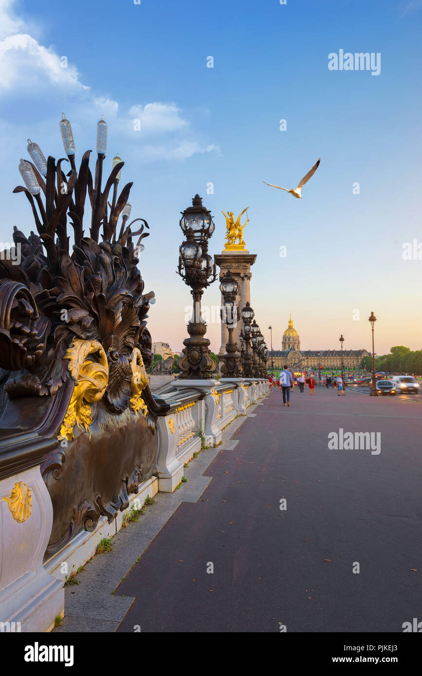 View on Les Invalides from bridge Alexandre III in Paris at sunset, France Stock Photo